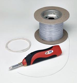 Fibra óptica recubierta de adhesivo térmico